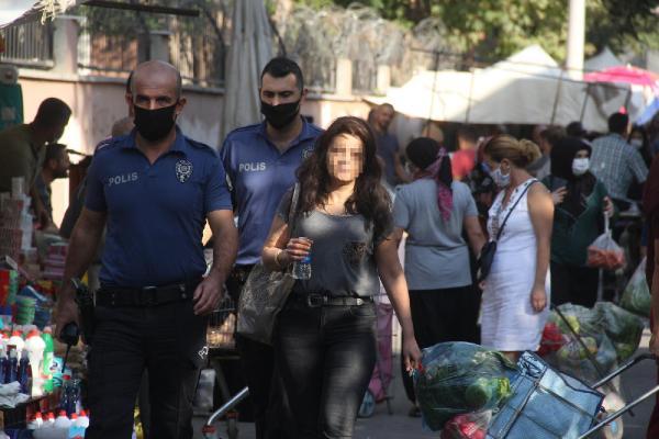 ADANA'DA, TARTISTIGI ESI MURAT F. TARAFINDAN EVE KILITLENEN SIBEL F. (FOTOGRAFTA) POLIS TARAFINDAN KURTARILDI.  FOTO:YUSUF KANTARLI/ADANA,(DHA)